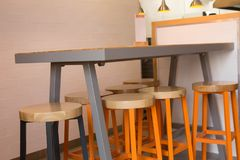 Bar table and chairs in the interior. Of the cafe Royalty Free Stock Images