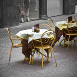 Bar table with colorful chairs in a Italian street Royalty Free Stock Images