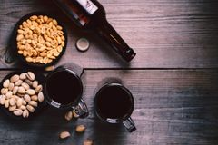 Bar table. dark beer and snacks set. Restaurant, pub, food concept. delicious drink and salty nuts. oktoberfest atmosphere, craft brewery background royalty free stock image