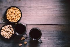 Bar table. dark beer and snacks set. Restaurant, pub, food concept. delicious drink and salty nuts. oktoberfest atmosphere, craft brewery background stock photos