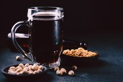 Bar table. dark craft stout beer and snacks set. Bar table. dark beer and snacks set. restaurant, pub, food concept. delicious drink and salty peanuts stock images
