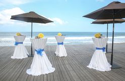Bar tables decorated for party or wedding with ocean view royalty free stock photography