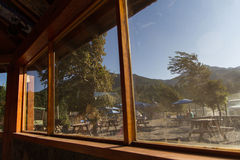 Bar tables at the outside. A bar windows lit by the sun at the afternoon royalty free stock photos