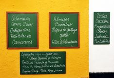 Bar of tapas specialized in fish, Cadiz, Spain. Blackboard with the gastronomic specialties of the bar placed on the facade, Andalusia, Spain Royalty Free Stock Photography