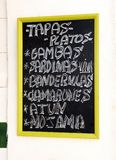 Bar of tapas specialized in fish, Seville, Spain. Blackboard with the gastronomic specialties of the bar placed on the facade, Andalusia, Spain Stock Images