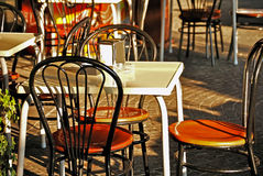 Bar terrace. Empty terrace bar with chairs and tables in a sunny day Royalty Free Stock Photo