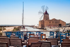 Bar with view of Mozia salt flats and an old windmill in Marsala Stock Photo