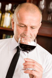 Bar waiter smell glass red wine restaurant Stock Photography