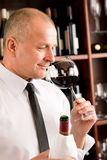 Bar waiter smell glass red wine restaurant Royalty Free Stock Photography