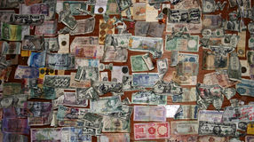 Bar wall with many pinned note. Bar wall with many pinned banknotes from many different countries Royalty Free Stock Image