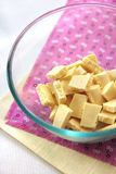 Bar of white chocolate broken into pieces Stock Photos