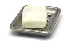 Bar of white soap in a holder Stock Image