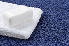 Bar of white soap and washcloth Royalty Free Stock Photo