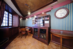 Bar in wooden closet and table in english cigar room Royalty Free Stock Photo