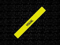 Bar in yellow. the word VISUAL is displayed. The background is black with tiles royalty free stock photo