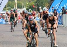 Barabara Riveros and Simone Ackermann cycling in the triathlon e Stock Photos