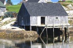 Baracche di pesca, baia della Peggy, Nuova Scozia Immagini Stock