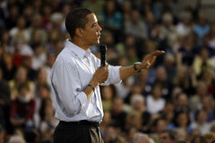 Barack Obama. Captured with an reassuring gesture toward a crowd of supporters.  Outreached hand has slight motion blur