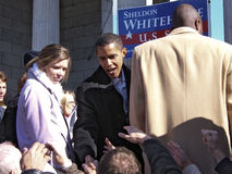 Barack Obama Shakes Hands. Barack Obama shaking hands at a political rally for Senator Sheldon Whitehouse on November 18, 2006, in Providence, Rhode Island royalty free stock photo