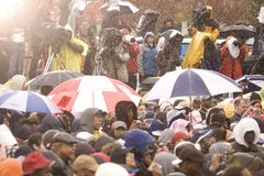 Barack Obama speaking at podium in pouring rain Royalty Free Stock Photos