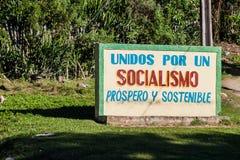 BARACOA, CUBA - FEB 5, 2016: Propaganda billboard in Baracoa. It says: United for the prosperous and sustainable. Socialism royalty free stock photo