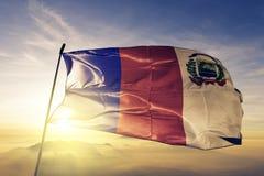 Barahona Province of Dominican Republic flag textile cloth fabric waving on the top sunrise mist fog. Beautiful royalty free stock photo