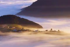 Barajuen village in Aramaio with morning fog Stock Photos