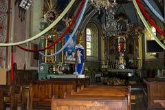 Baranow Sandomierski, drzwi i wnętrze stary kościół, fotografia royalty free