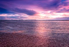 Barassie Shore Troon in Ayrshire Scotland with red moody sky. On a summer night royalty free stock photo