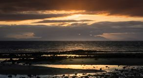 Barassie Shore Troon in Ayrshire Scotland with red moody sky. On a summer night royalty free stock photography
