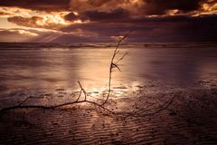 Barassie Shore Troon in Ayrshire Scotland with red moody sky. On a summer night stock images