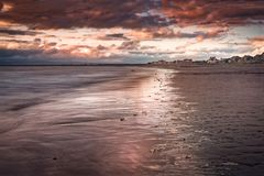 Barassie Shore Troon in Ayrshire Scotland with red moody sky. On a summer night stock photography
