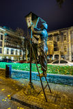 Baratashvili Street. The bronze monument of the lamplighter with Royalty Free Stock Photos