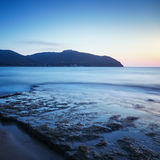 Baratti bay, headland hill, rocks and sea on sunset. Tuscany, It Royalty Free Stock Photos