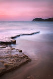 Baratti bay, headland hill, rocks and sea on sunset. Tuscany, It Royalty Free Stock Image