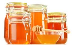 Barattoli di miele su bianco Immagine Stock