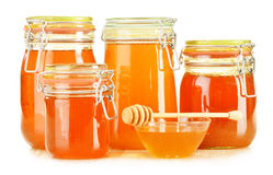 Barattoli di miele su bianco Immagine Stock Libera da Diritti