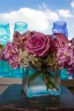 Barattoli di vetro e del fiore Fotografia Stock Libera da Diritti
