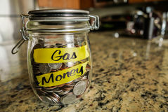 Barattolo dei soldi del gas Immagini Stock