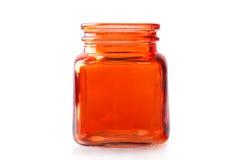 Barattolo di vetro arancio vuoto Fotografia Stock