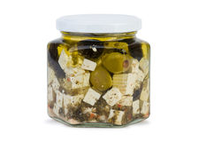 Barattolo di vetro con il formaggio di fitaki in olio e nelle olive Immagine Stock
