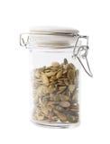 Barattolo di vetro riempito di semi di zucca Fotografia Stock