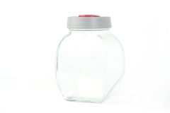 Barattolo di vetro sopra fondo bianco Fotografia Stock
