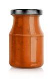 Barattolo rosso della salsa di pasta Fotografia Stock