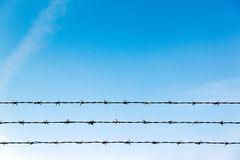 Barb wire. Triple Barb wire against blue sky Royalty Free Stock Photo