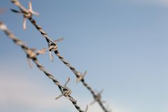 Barb wire. Old barbwire against blue sky Royalty Free Stock Image