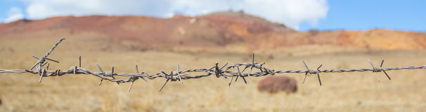 Barb wire on a desert landscape Royalty Free Stock Photography