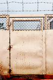 Barb wire door Stock Image