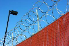 Barb wire fence. To protect the property Royalty Free Stock Images