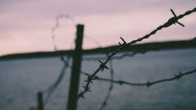 Barb wire fence at seaside Royalty Free Stock Images